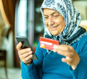 Elderly lady using online banking