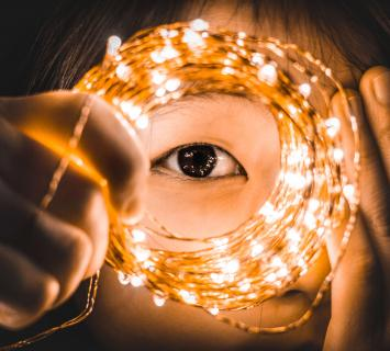 Child gazing through a spiral of lights